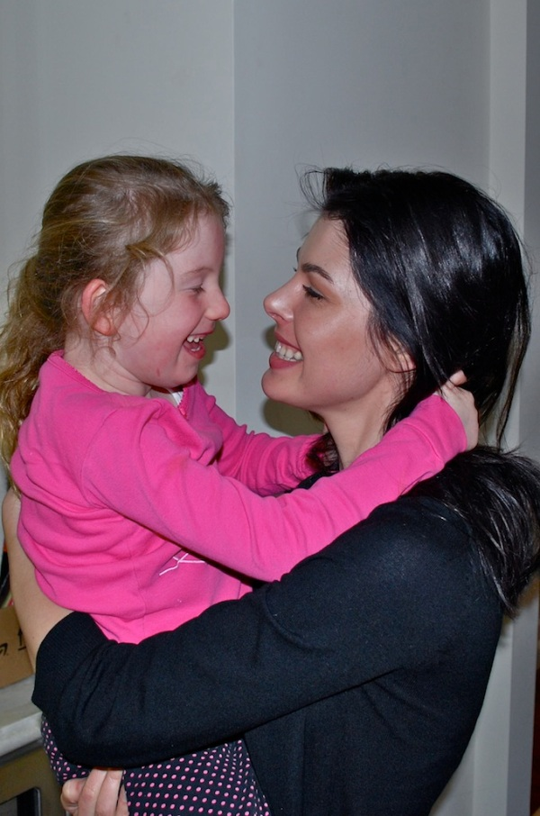 Linda embracing Hannah. (Hannah is diagnosed with Rett Syndrome )